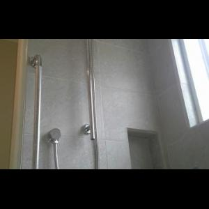 Long handled shower on a slider bar for sit down or stand up use